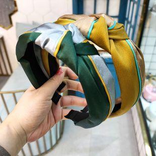 Moda coreana de alta gama de tela color caramelo diadema anudada simple banda de pelo de ala ancha moda hit color accesorios para el cabello al por mayor nihaojewelry NHUX222351's discount tags