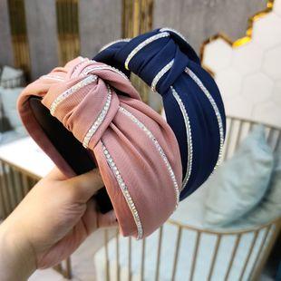 Diadema anudada de diamantes de imitación de color de gama alta coreana tela simple de ala ancha tela exquisita horquilla diadema de presión de moda al por mayor nihaojewelry NHUX222362's discount tags