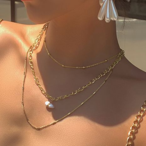 fashion simple street shooting the same multi-layer necklace reative cold wind pearl pendant necklace wholesale nihaojewelry NHMD222437's discount tags