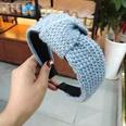 NHUX713677-Spiral-knotted-headband-of-light-blue-wool