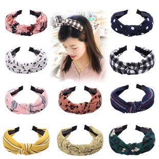 wide-brimmed fabric knotted hair hoop Korean simple toothed non-slip hairpin wild wave dot hair accessories ladies wholesale nihaojewelry NHUX222522's discount tags