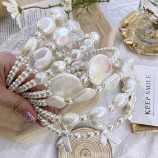 Diadema de perlas de moda coreana para damas simples moda pelo salvaje agujero novia diadema tocado al por mayor nihaojewelry NHSM222210's discount tags