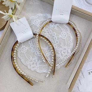 Diadema de leopardo de perlas de moda coreana, aleación de onda salvaje, combinación de agujero de pelo fino, diadema, presión, pelo, venda para mujer, nihaojewelry al por mayor NHSM222214's discount tags