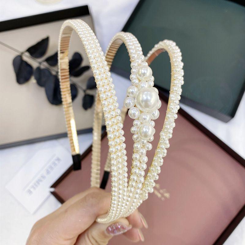 Korean fashion sweet twist  braid pearl hair hoop female Korean ladies hair accessories wave bride fine edge headband wholesale nihaojewelry NHSM222220