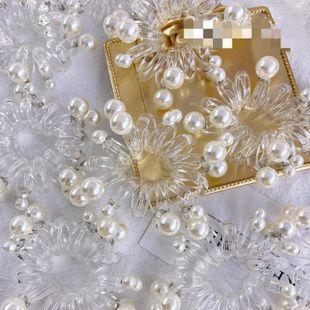 Gomas para el cabello coreanas línea de teléfono anillo de pelo de perlas simples transparentes perlas de uñas grandes sin costura cuerda para el cabello accesorios para el cabello al por mayor nihaojewelry NHSM222225's discount tags