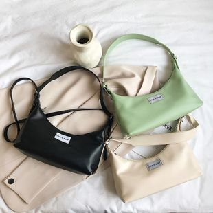Retro wild solid color shoulder armpit bag female  new  simple style fashion casual portable baguette nihaojewelry wholesale NHPB222944's discount tags