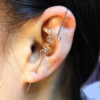 Nuevos pendientes street fashion hombres y mujeres pendientes perforados personalidad simple carta de amor clips de oreja al por mayor nihaojewelry NHMO223442's discount tags