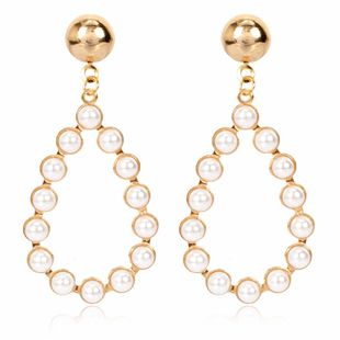 Creative minimalist personality geometric oval alloy inlaid pearl earrings retro earrings wholesale nihaojewelry NHCT223484's discount tags