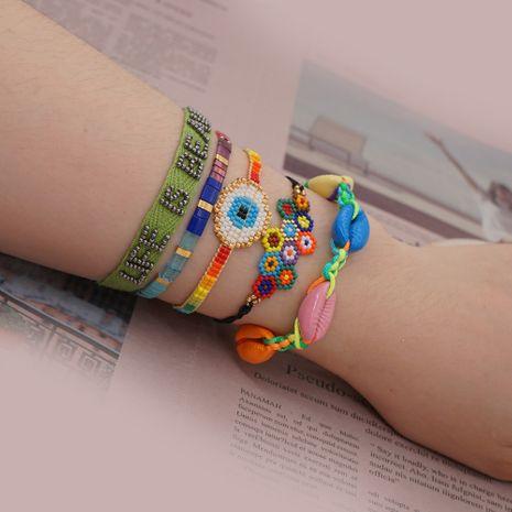 Pulsera de estilo étnico concha de arco iris natural conchas de arroz Miyuki tejidas ojo de la suerte joyería hecha a mano al por mayor nihaojewelry NHGW223537's discount tags