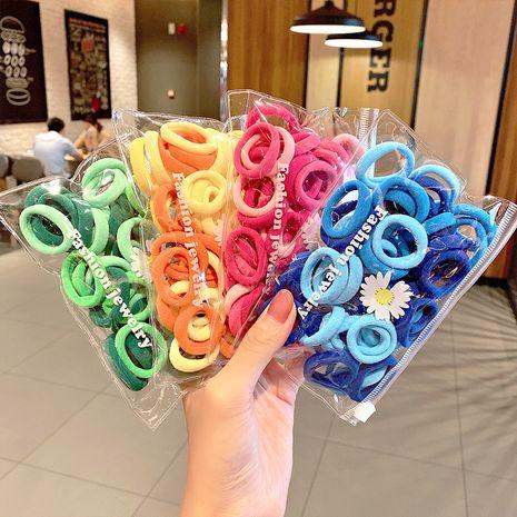 50 pequeñas margaritas embalaje de nylon coreano anillo para el cabello color toalla anillo simple moda cabeza cuerda accesorios para el cabello cuerda para el cabello venta al por mayor nihaojewelry NHNA223590's discount tags