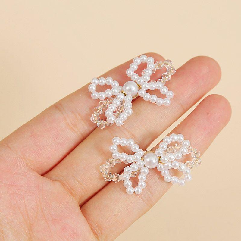 Korean cute silver needle handmade pearl crystal butterfly earrings new trendy temperament woven earrings jewelry wholesale nihaojewelry NHLA223700