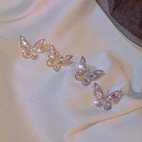 S925 plata esterlina aguja estilo retro pendientes de mariposa diamantes de imitación brillantes pequeños pendientes nuevo temperamento pendientes de hadas al por mayor nihaojewelry NHXI223706