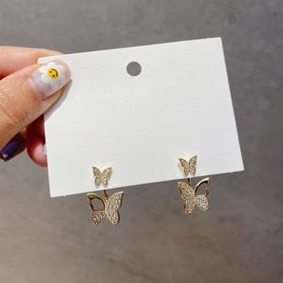 Moda coreana doble mariposa linda colgantes pendientes de mariposa de diamantes de imitación pendientes de alto sentido pendientes de temperamento al por mayor nihaojewelry NHXI223712's discount tags