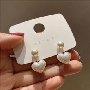 925 aguja de plata simple pequeño amor pendientes de perlas pendientes de niña coreana pendientes de temperamento salvaje al por mayor nihaojewelry NHXI223719's discount tags