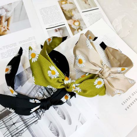 South Korea's new small daisy bow headband high-end wide-edge printing hairpin super fairy rabbit ear headband girl wholesale nihaojewelry NHUX223789's discount tags