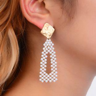 Pendientes largos simples Pendientes de moda coreana pendientes geométricos dulces pendientes de perlas huecas niña corazón cuentas de arroz al por mayor nihaojewelry NHMO223829's discount tags