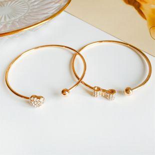 fashion full diamond bow peach heart bracelet semi-open curved adjustable bracelet wholesale nihaojewelry NHDP233412's discount tags