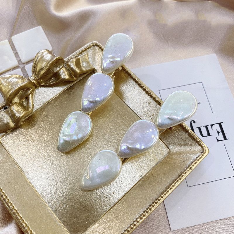 Korean girl hair accessories shell pearl hairpin alloy hairpin women's head side clip wholesale nihaojewelry NHSM233619