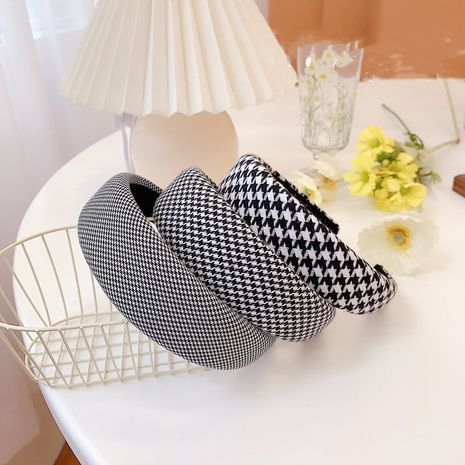 Korean houndstooth sponge fashion wide-brimmed headband wholesale nihaojewelry NHSM233627's discount tags