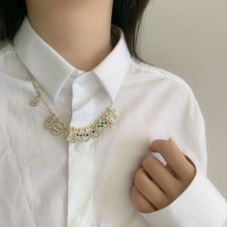 Collier coréen perle ronde chaîne alphabet smiley visage micro-ensemble pendentif clavicule chaîne ras du cou collier en gros nihaojewelry NHYQ233953's discount tags
