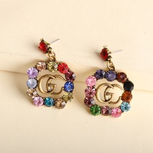 New Korean trendy fashion G letter glass color diamond earrings trend wholesale nihaojewelry NHJJ234030's discount tags