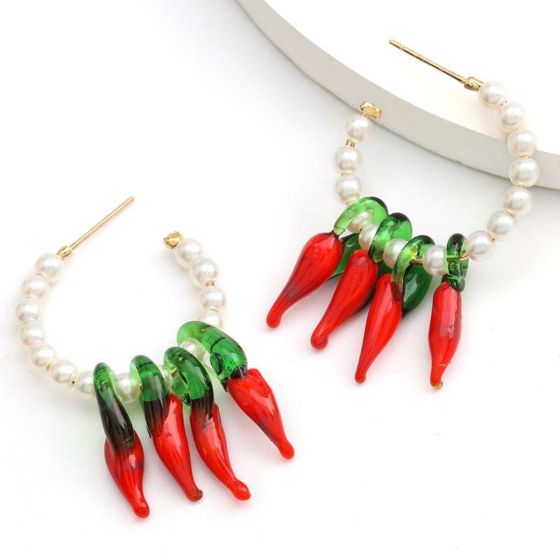 C-shaped alloy imitation pearl multi-layer pepper-shaped resin tassel earrings wholesale nihaojewelry NHJE234042