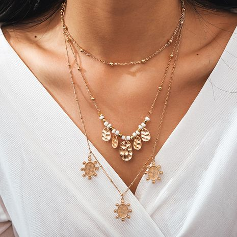 nouveau alliage bijoux rétro style ethnique ronde pièce de monnaie soleil multicouche collier de perles de riz en gros nihaojewelry NHGY234116's discount tags