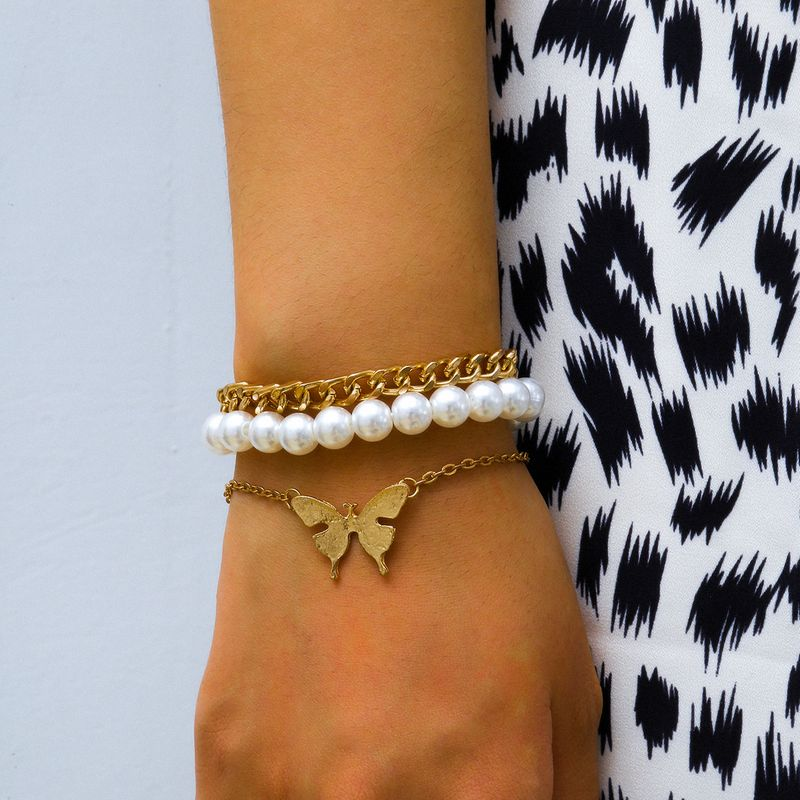 creative jewelry simple imitation pearl jewelry alloy butterfly bracelet wholesale nihaojewelry NHXR234265