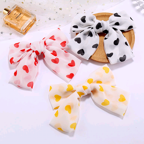 Korean fashion simple chiffon love big bow hair accessories hair clip side clip wholesale nihaojewelry NHSC234299's discount tags