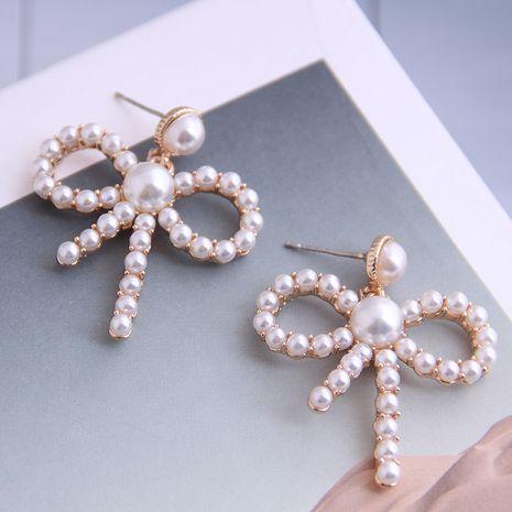 Boutique mode coréenne douce OL bowknot boucles d'oreilles en perles en gros nihaojewelry NHSC234292's discount tags
