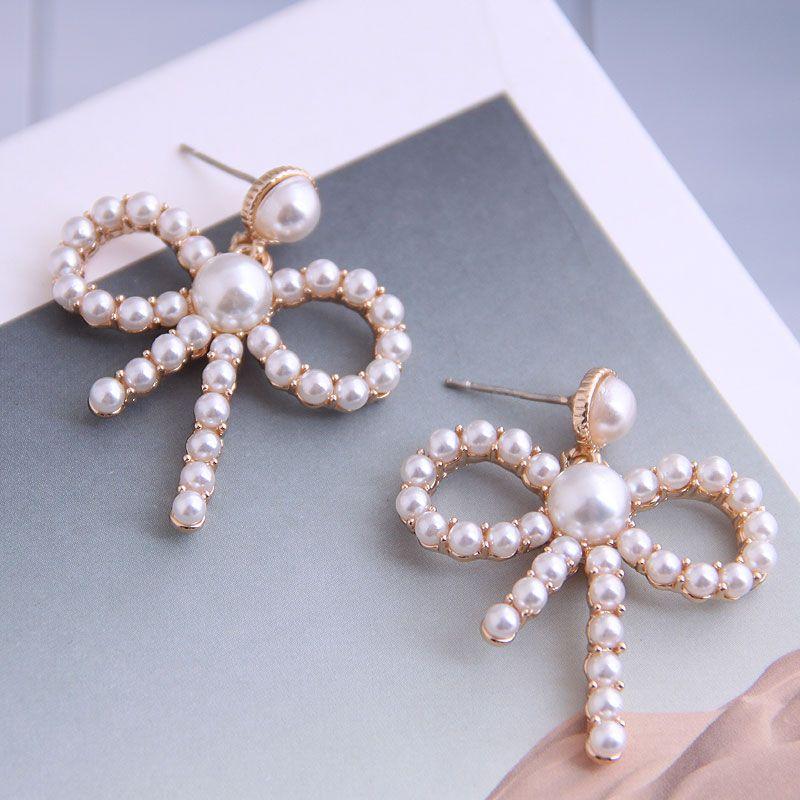 Boutique Korean fashion sweet OL bowknot pearl earrings wholesale nihaojewelry NHSC234292