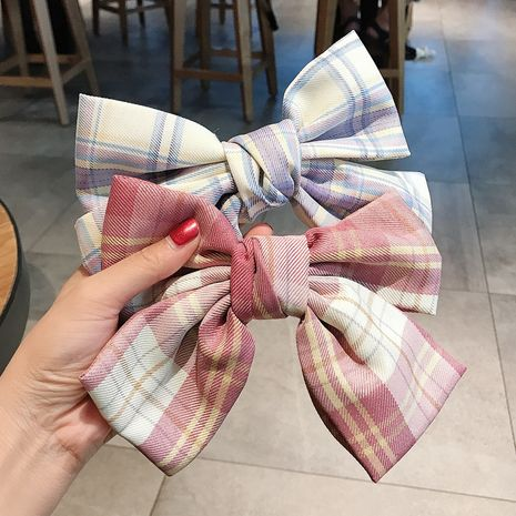 Korean girl's bow hairpin side clip hairpin side hair jewelry wholesale nihaojewelry NHDQ234303's discount tags
