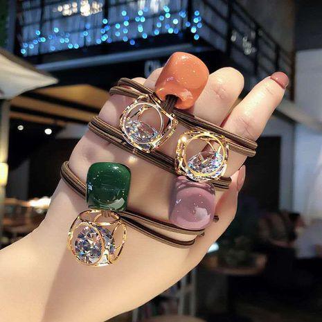 coréenne tête corde creuse cristal cheveux cravate cheveux strass bande de caoutchouc simple cheveux corde en gros nihaojewelry NHNA234313's discount tags