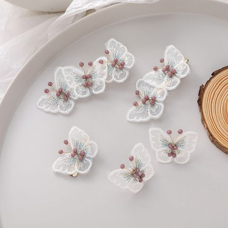 Korean 925 silver needle purple gray crystal butterfly earrings hairpin duckbill clip bangs accessories wholesale nihaojewelry NHMS234337's discount tags