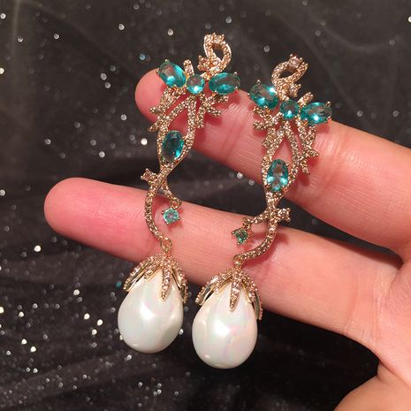 Blue flower earrings elegant round S925 silver needle long tassel pearl pendant earrings wholesale nihaojewelry NHWK234344's discount tags