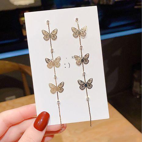 925 aguja de plata coreana verano nueva mariposa pendientes largos borla pendientes oreja joyería al por mayor nihaojewelry NHXI234417's discount tags