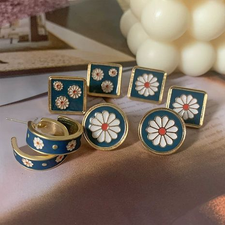 High-quality retro enamel ink blue small daisy earrings flower earrings new wave wholesale nihaojewelry NHXI234418's discount tags