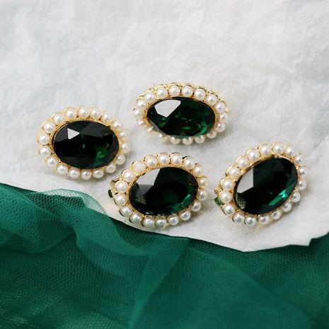 Pendientes de piedras preciosas de resina facetada verde esmeralda clips de oreja ovalados 925 pendientes de aguja de plata al por mayor nihaojewelry NHOM234522's discount tags