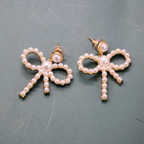 Hollow Bow Silver Needle Earrings Small Pearl Elegant Bow Knot Earrings Sweet Earrings wholesale nihaojewelry NHOM234526's discount tags