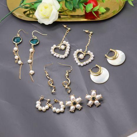 Corea 925 pendientes de aguja de plata clip de oreja pendientes de concha de perla cultivada natural al por mayor nihaojewelry NHOM234532's discount tags