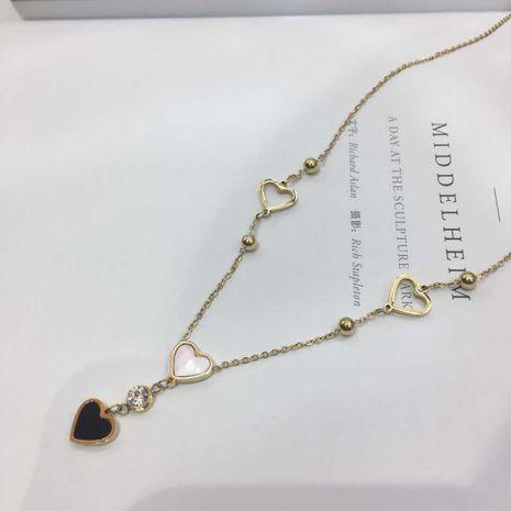 Titane acier plaqué or 18 carats diamant double face collier d'amour chaîne de clavicule simple pendentif en gros nihaojewelry NHIM234650's discount tags