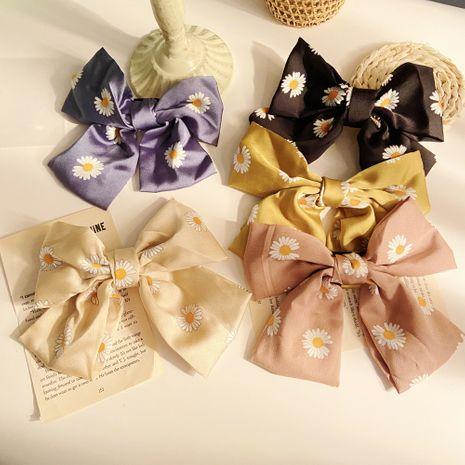 fashion daisy big bow word clip hairpin Korean back clip headdress wholesale nihaojewelry NHPJ234675's discount tags
