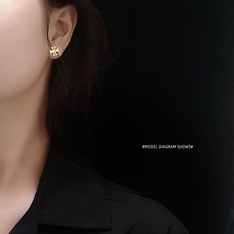 T-shaped carved exquisite earrings jewelry titanium steel plated 18K real gold ear jewelry wholesale nihaojewelry NHOK235198's discount tags