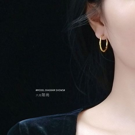 steel material titanium steel real gold wild earrings bone joint hoop earring women NHOK235200's discount tags