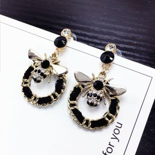 Korean autumn and winter earrings cute bee flash drill earrings geometric weave winding hand-made earrings wholesale nihaojewelry NHFT235379's discount tags