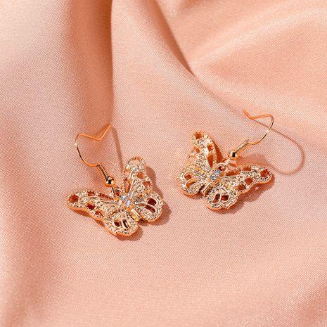 New fashion wild metal hollow butterfly earrings cold wind creative love key earrings nihaojewelry wholesale NHMO214008's discount tags