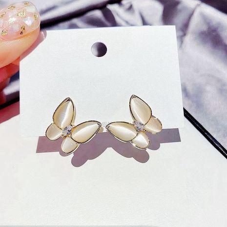 Coréen beau papillon boucles d'oreilles S925 aiguille d'argent incrusté de zirconium diamant opale boucles d'oreilles en gros nihaojewelry NHCG235402's discount tags