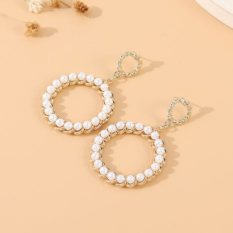 Korean new  retro wild personality fashion trendy  large circle pearl hollow earrings nihaojewelry wholesale   NHPS235605's discount tags
