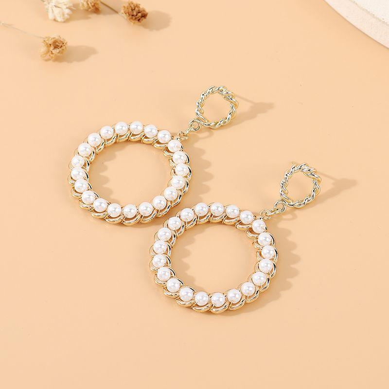 Korean new  retro wild personality fashion trendy  large circle pearl hollow earrings nihaojewelry wholesale   NHPS235605