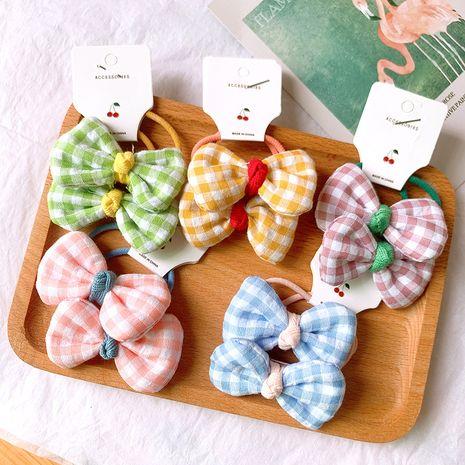 El color del caramelo de la muchacha de la cuerda del pelo de los niños coreanos no daña la banda elástica del pelo lindo arco a cuadros gomas para el cabello baratas nihaojewelry al por mayor NHSA230766's discount tags